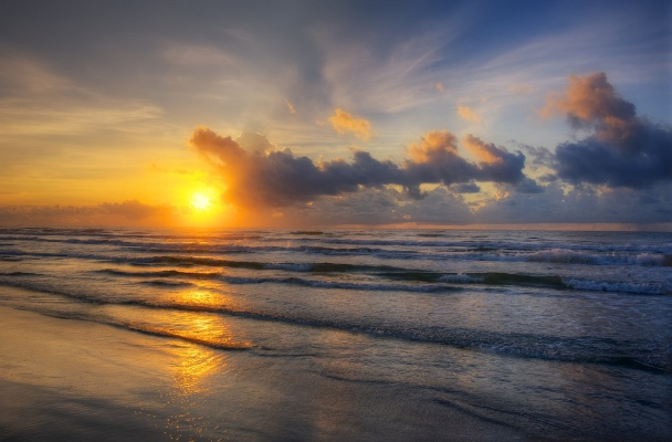 Port Aransas sunrise by Jim Nix of Nomadic Pursuits